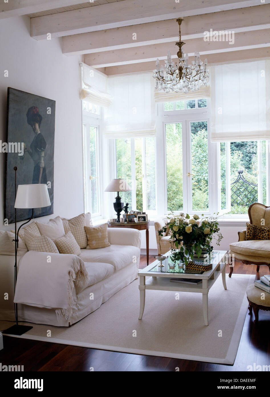 Coffee Table On White Rug In Front Of Sofa Country Living Room With Lime Washed Ceiling Beams