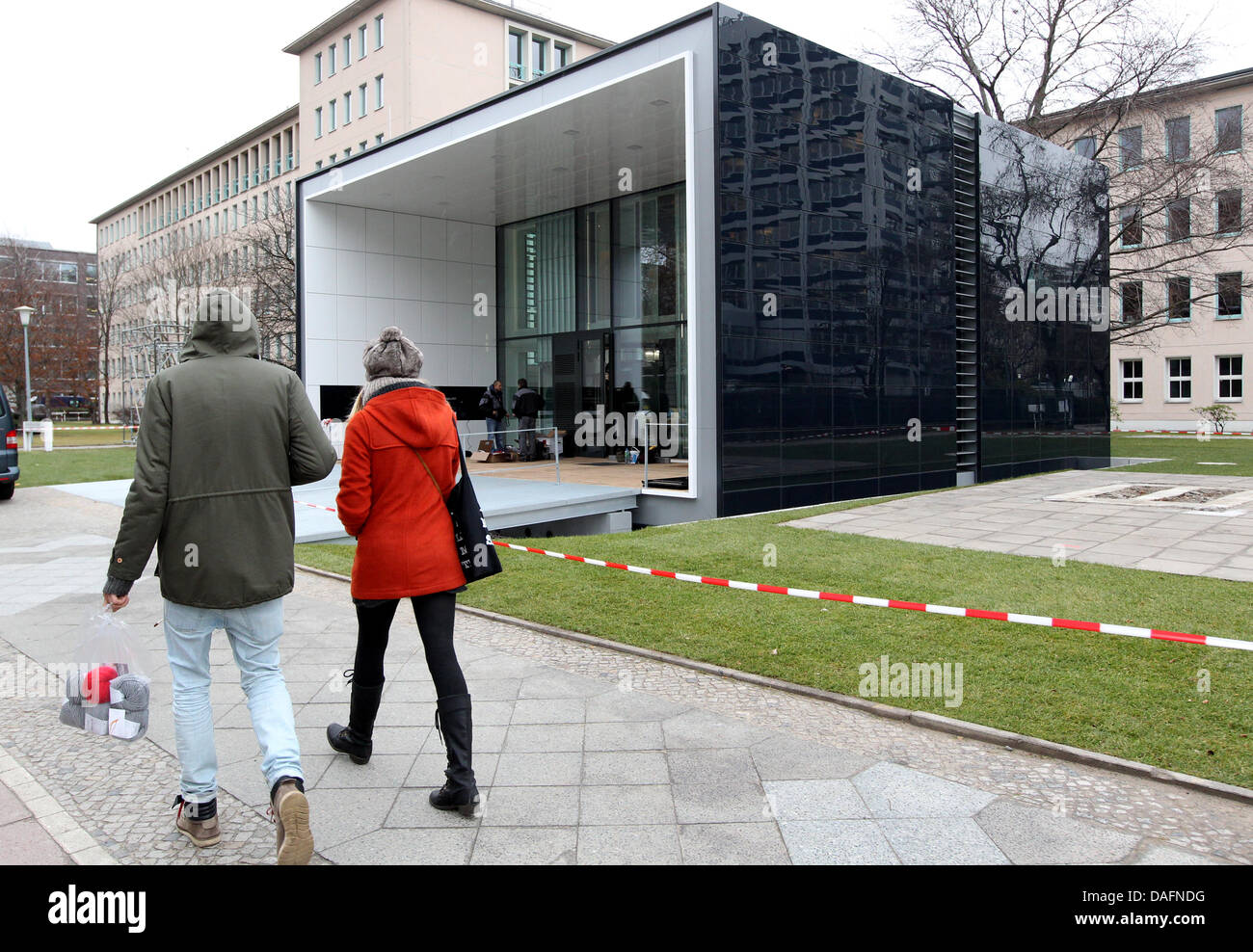 Pedestrians Walk Past The Energy Plus House With Electric Mobility In  Berlin, Germany, 06 December 2011. The Newly Constructed Building Will Be  Opened On ...