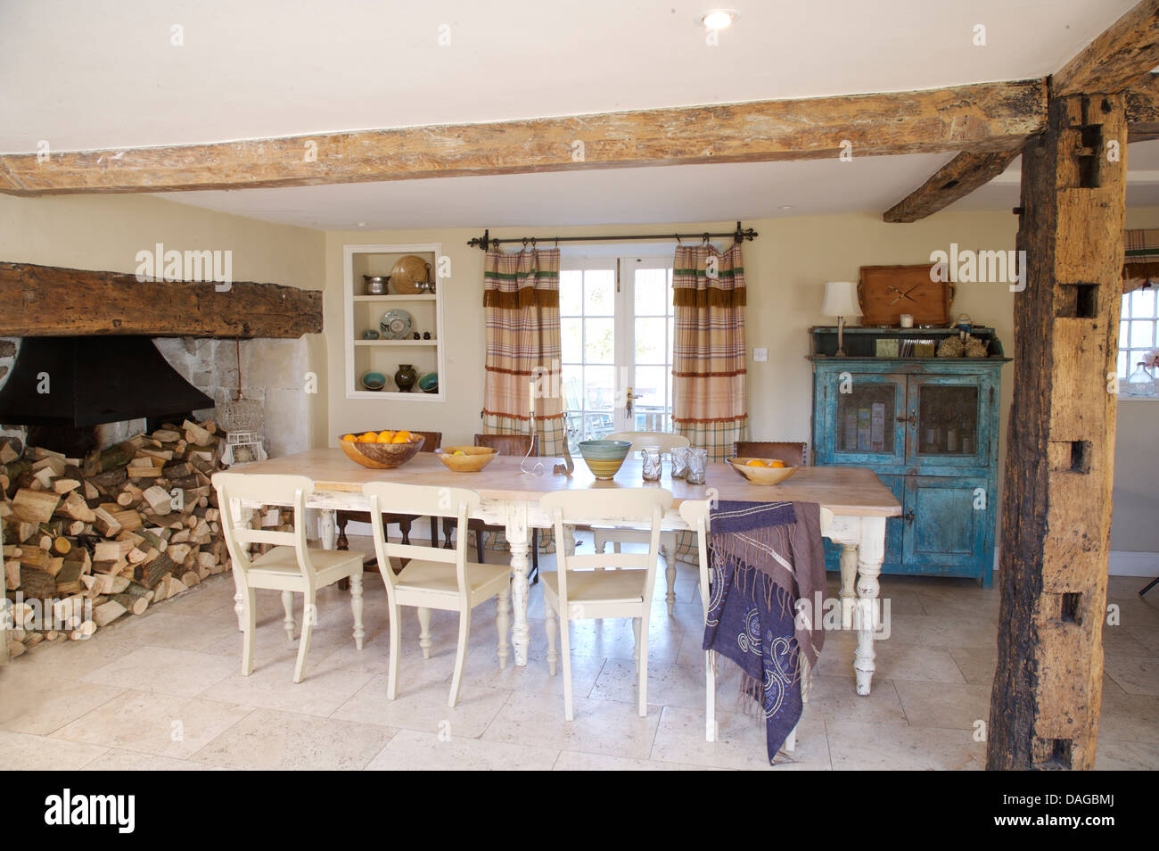 White Painted Chairs And Table In Country Dining Room With Large