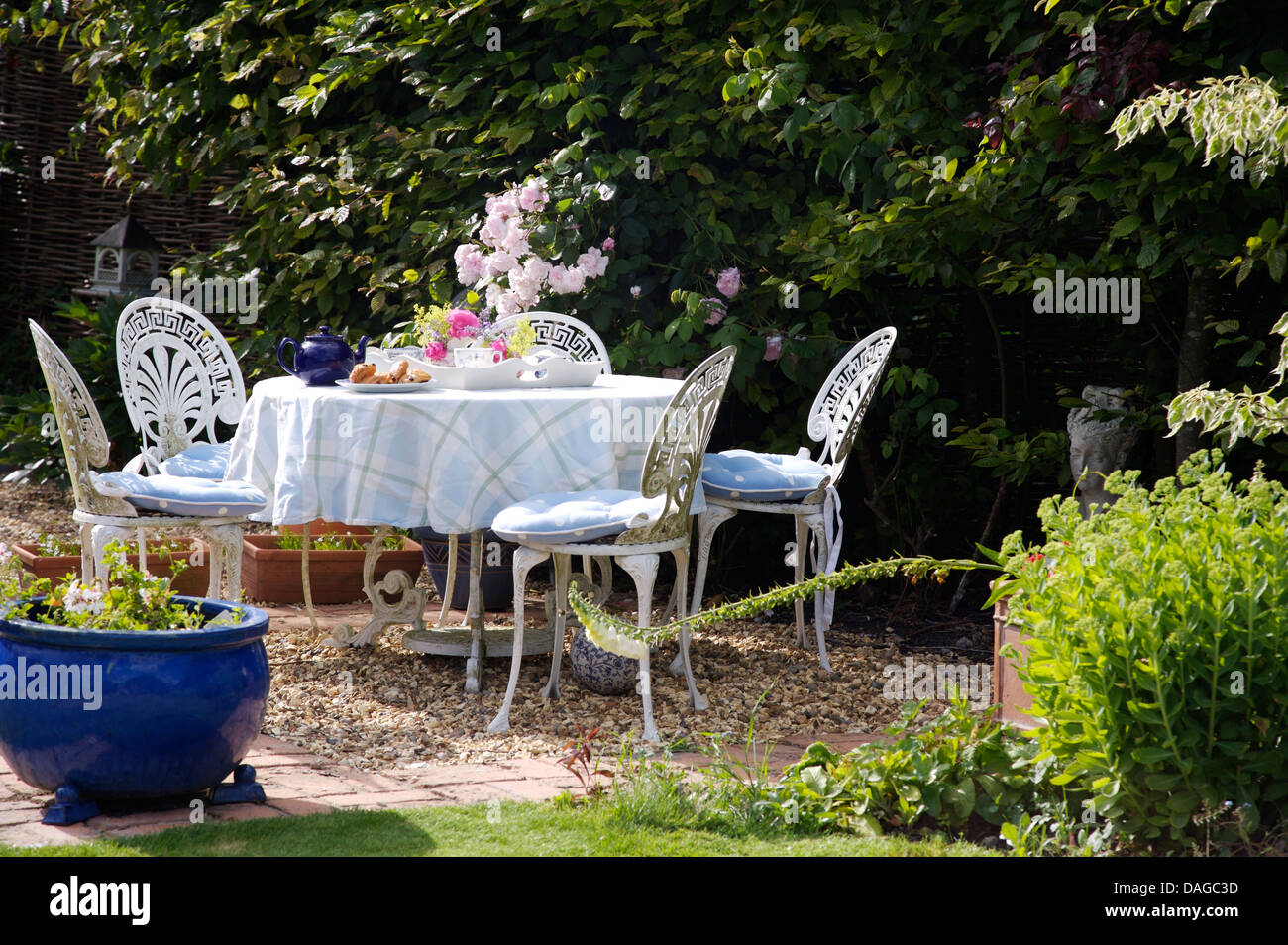 White Wrought Iron Chairs Part - 41: Stock Photo - White Wrought Iron Chairs And Table With Checked Cloth Set  For Tea In Country Garden In Summer
