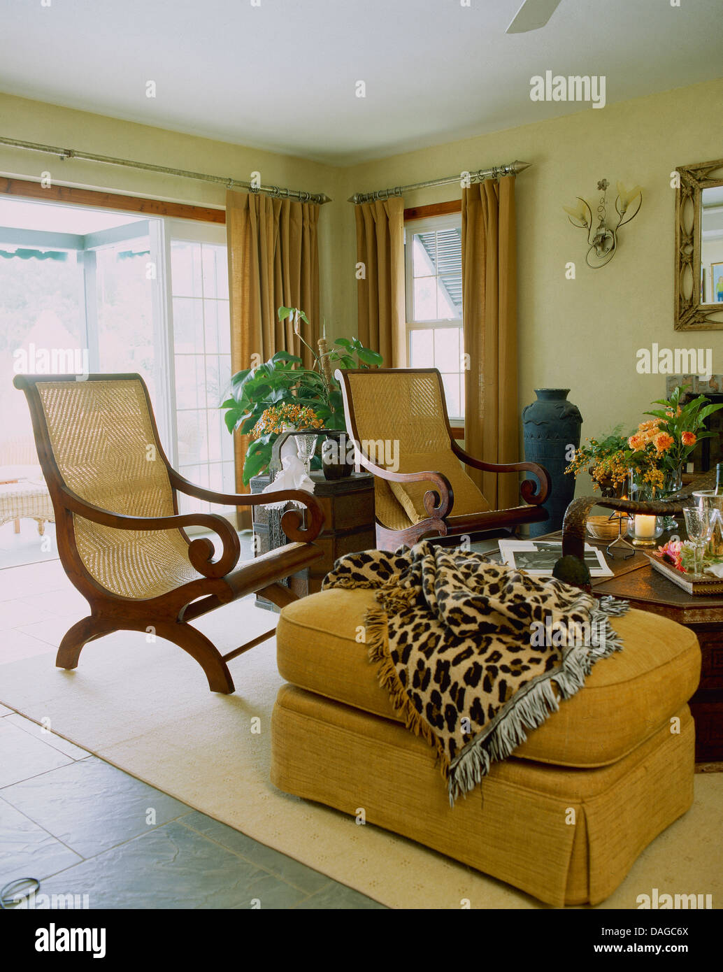 Cane Back Planteru0027s Chairs And Yellow Ottoman Stool With Leopard Print  Throw In Country Living Room
