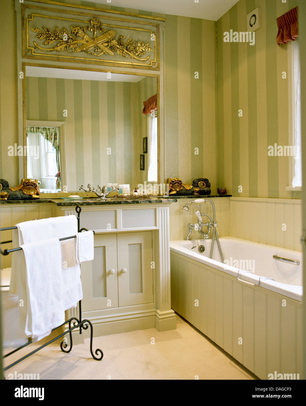 Tongue and groove for bathrooms - Large Ornate Mirror Above Basin In Bathroom With Striped Wallpaper And Painted Tongue Groove Paneling On Bath