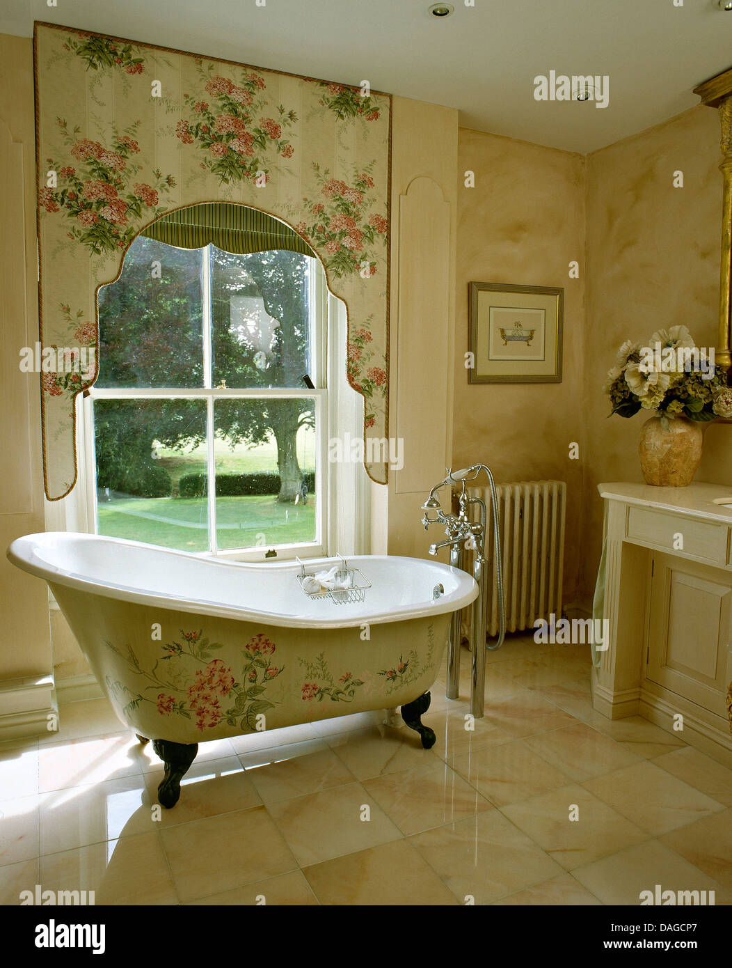 Bathroom With Matching Floral Pattern On Side Of Victorian Style Bath And  Lambrequin Above Window