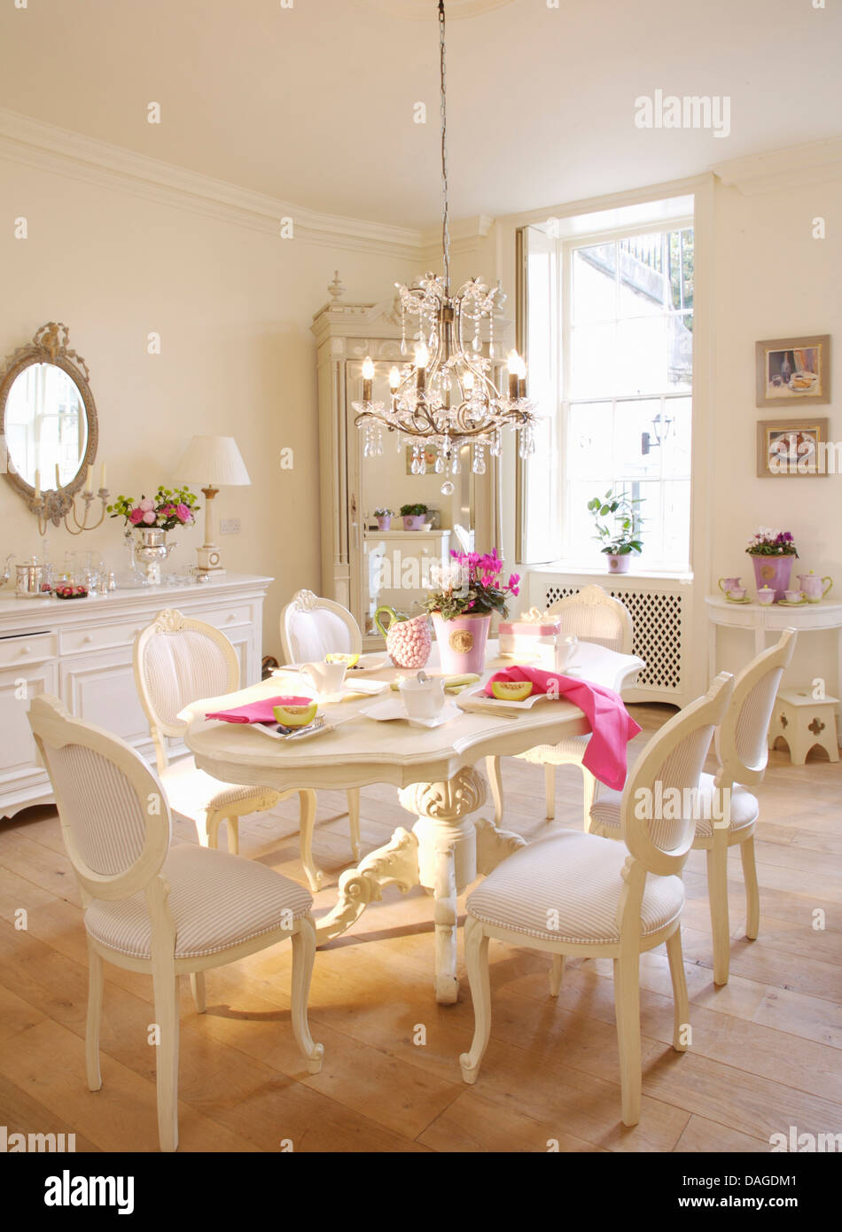 white french style chairs and painted oval table in white
