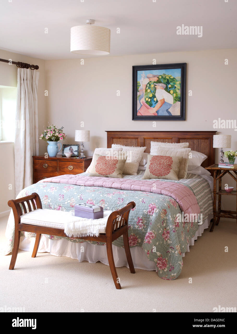 Wooden bench seat at foot of double bed with wooden headboard and stock photo royalty free - Seat at foot of bed ...