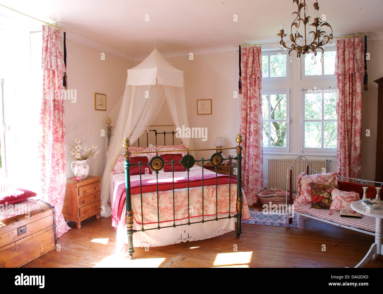 White Voile Mosquito Net Above Brass Bed With Toile De