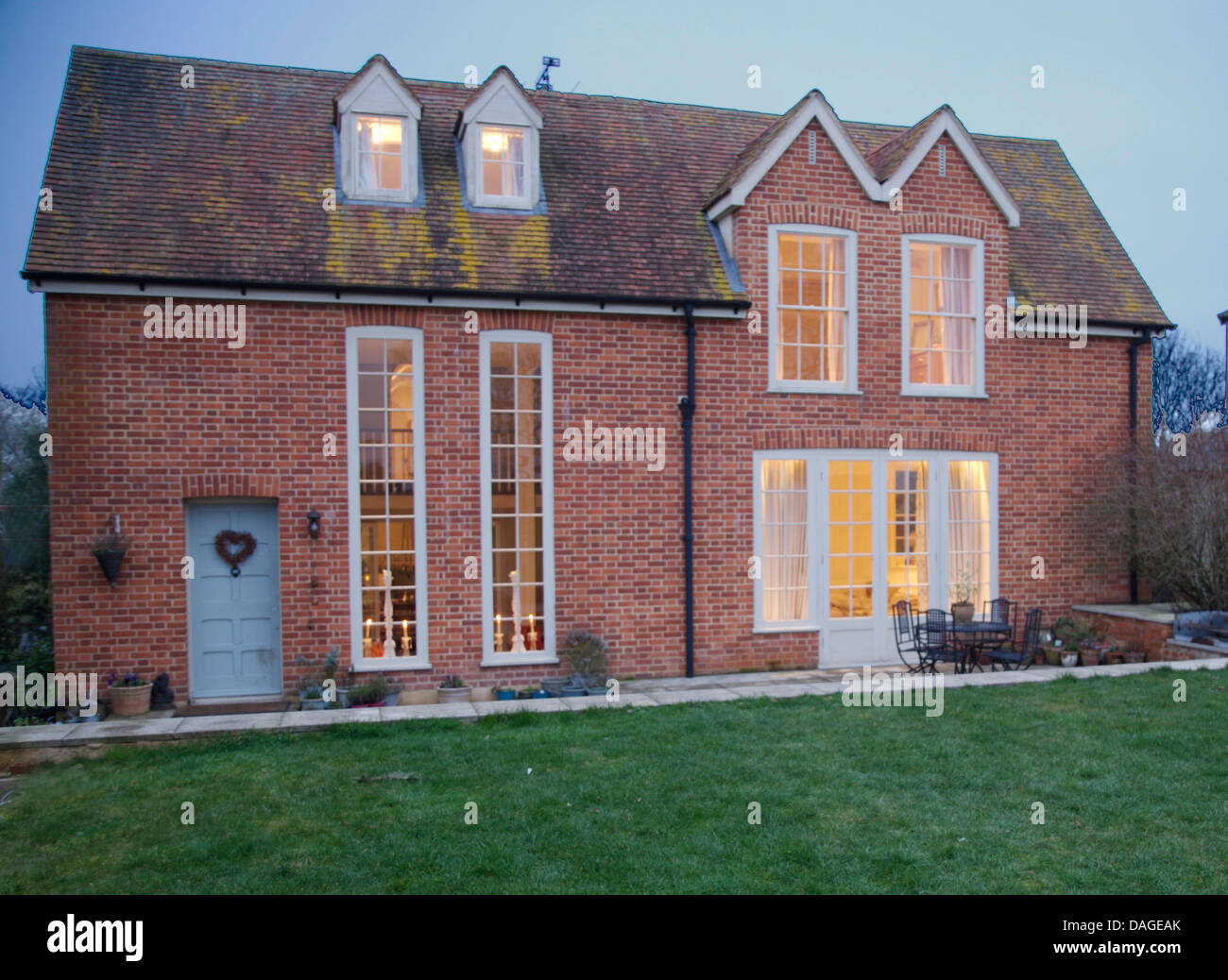 Exterior of brick built country house with tall narrow for Tall narrow windows