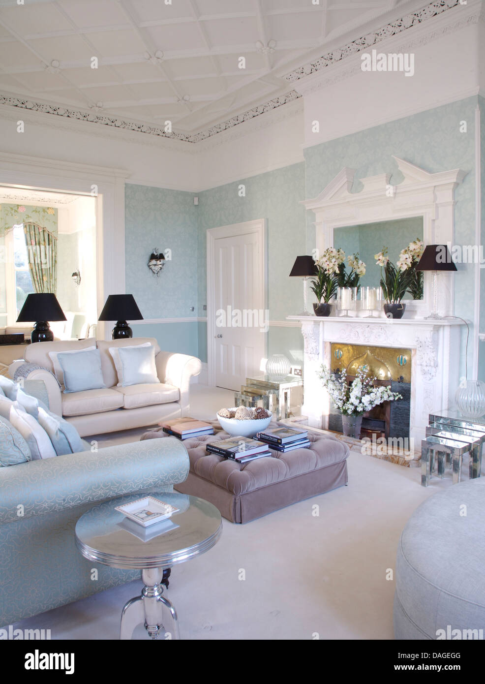 Edwardian Living Room White And Pale Blue Sofas Around Gray Velvet Ottoman In Front Of Fireplace
