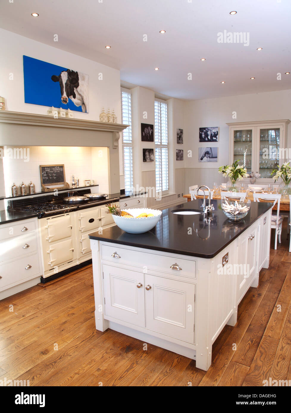 Island unit in modern white country kitchen with white aga for Country kitchen flooring