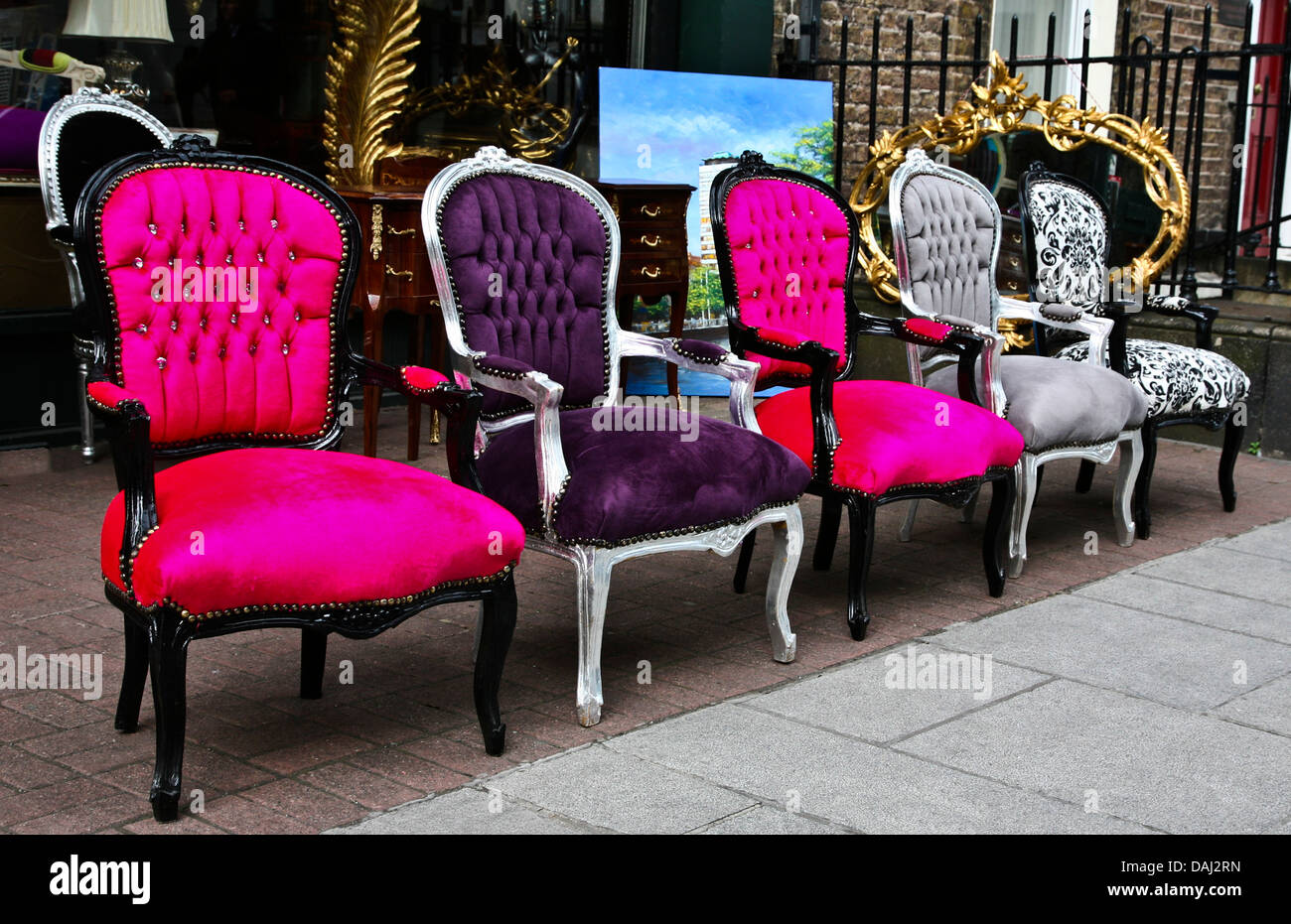 Colorful outdoor close up Victorian antique chairs displayed in a row in  front of an antique store in Dublin, Ireland, vintage objects, chair  abstract - Colorful Outdoor Close Up Victorian Antique Chairs Displayed In A