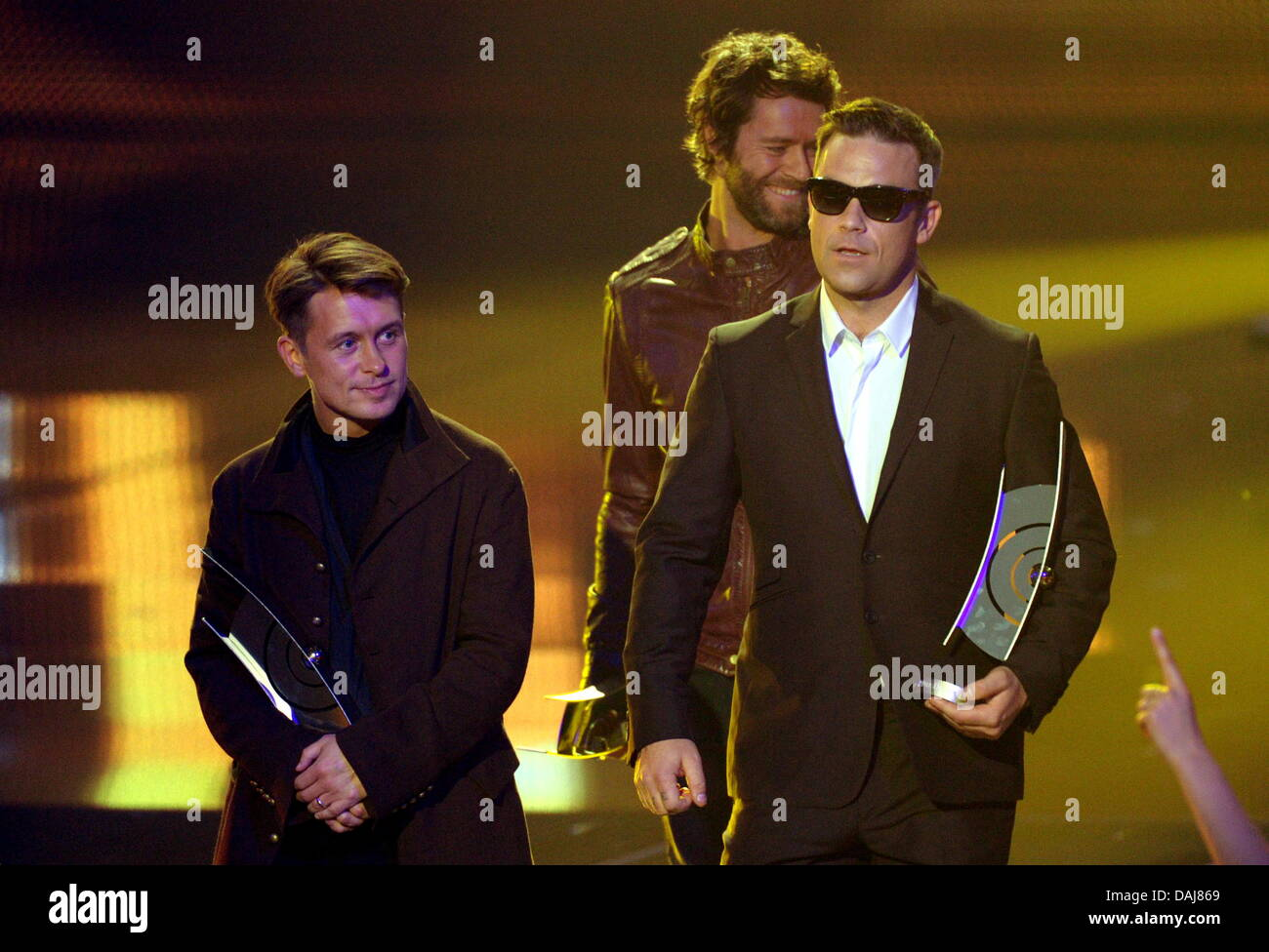 Mark Owen (lr), Howard Donald And Robbie Williams (c) Of British Band Take  That Receive The 2011 Echo Music Award In The Category Best International  Group
