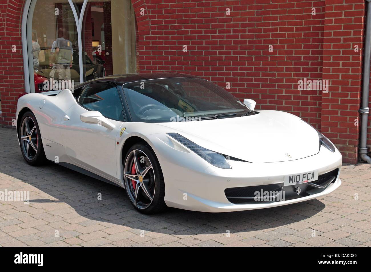 ferrari italia white. a white ferrari 458 italia outside meridien modena, official dealer in lyndhurst, hampshire, uk l