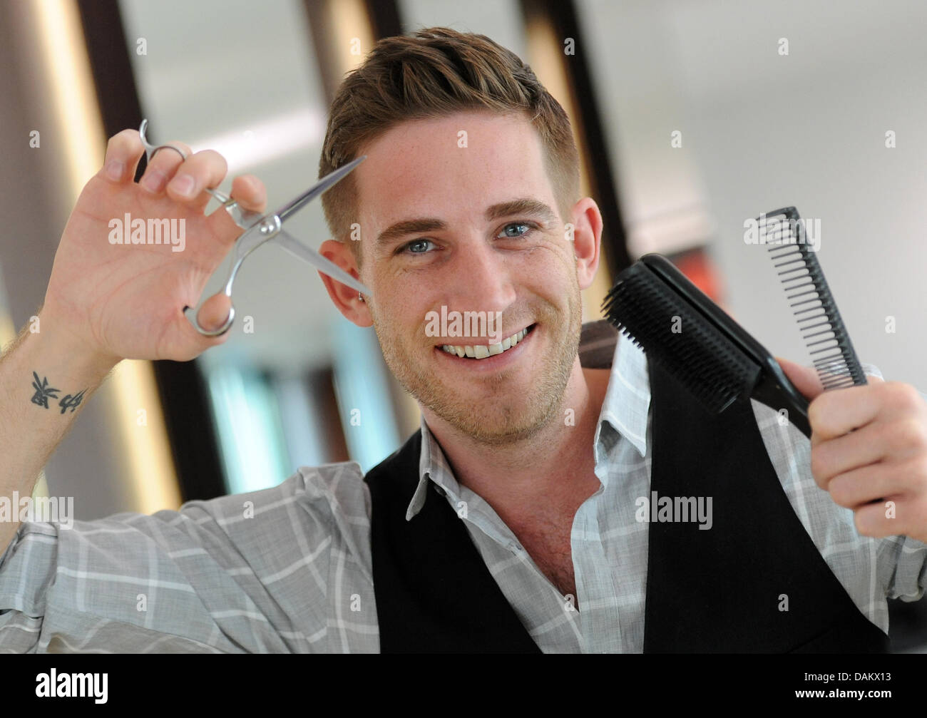 hair stylist dennis creuzberg is pictured at work in berlin germany stock photo royalty free. Black Bedroom Furniture Sets. Home Design Ideas