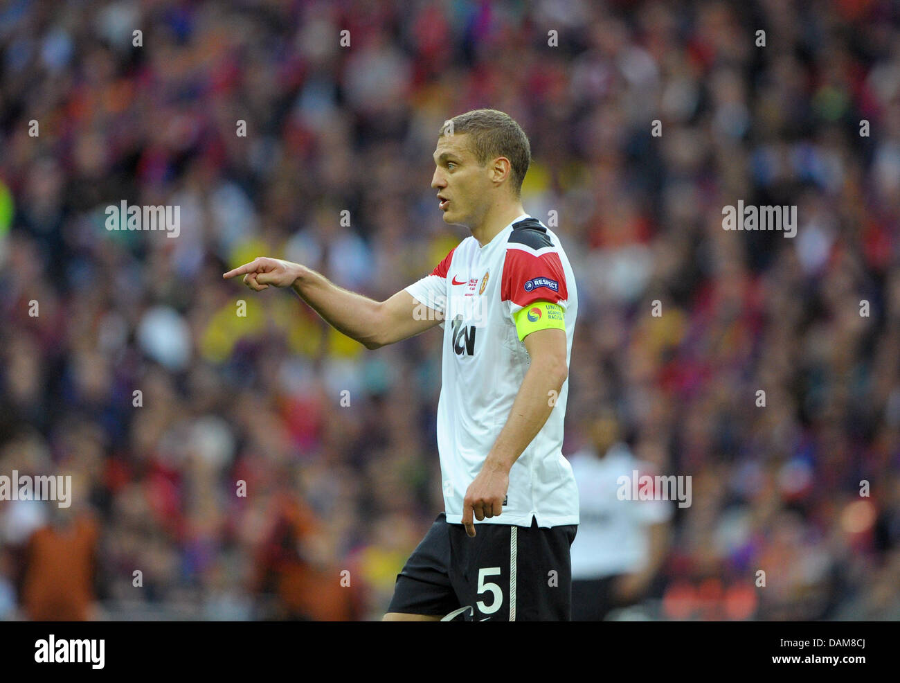 Manchester s Nemanja Vidic gestures during the UEFA Champions