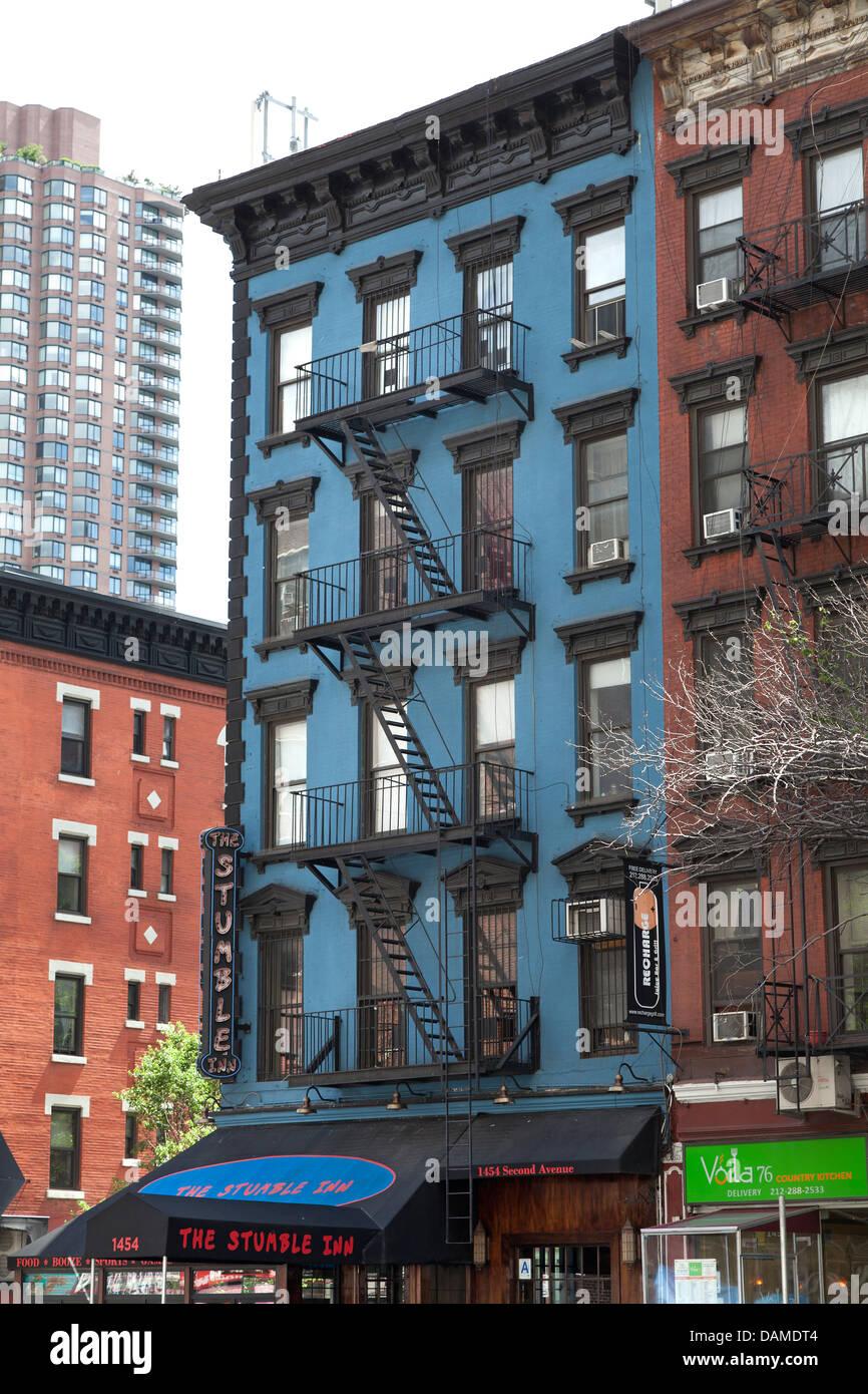 Colorful apartment buildings with fire escapes in New York City