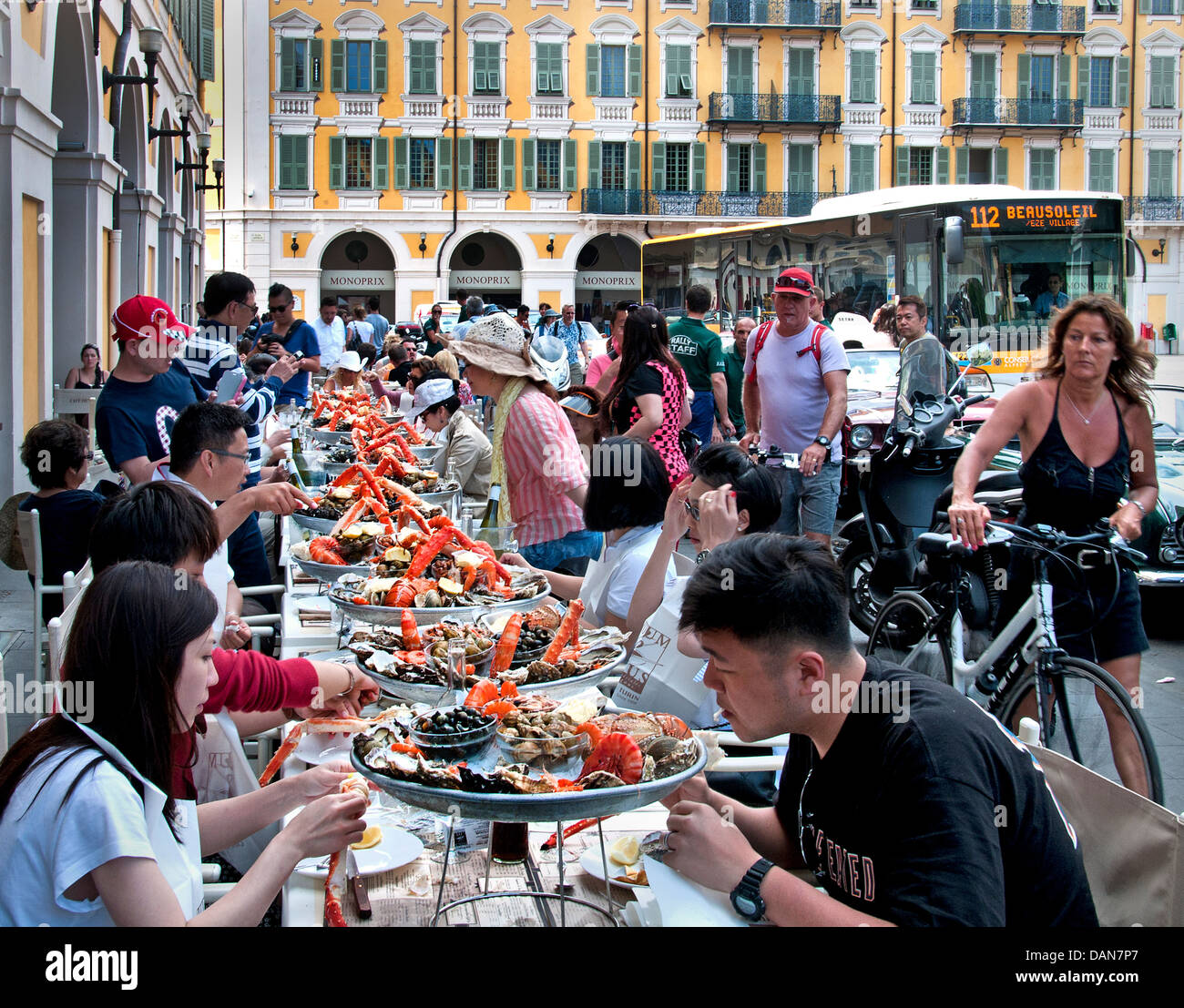 lunch cafe de turin nice france chinese people fruits de mer french stock photo royalty free. Black Bedroom Furniture Sets. Home Design Ideas