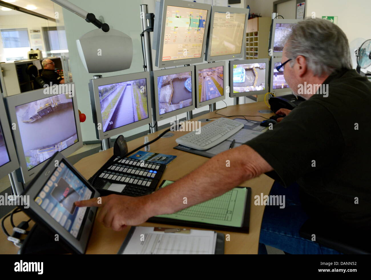 shift supervisor manfred badermann watches his screens while the shift supervisor manfred badermann watches his screens while the interior cruise ship river harmony under the maltese flag enters the locks in kostheim
