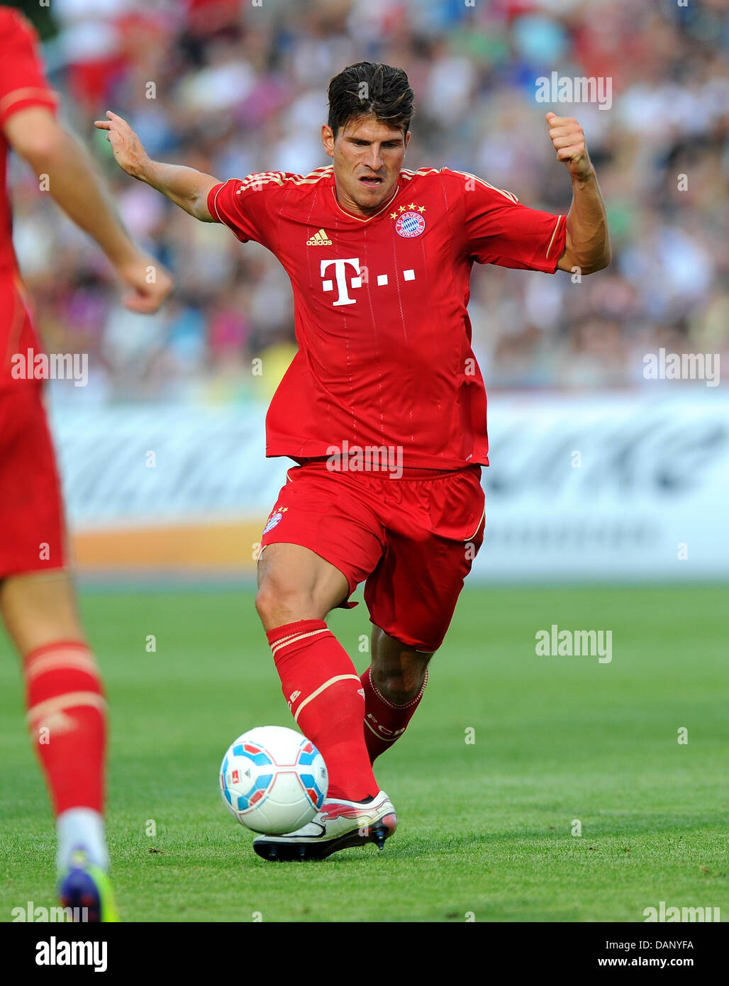 Mario Gomez of FC Bayern Munich controls the ball during the