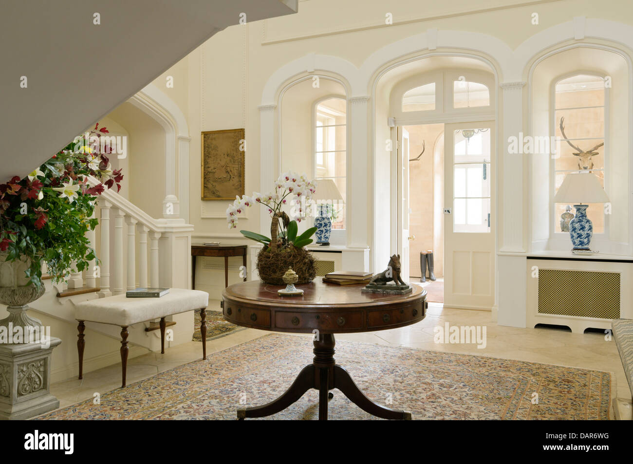 Antique Round Table In Entrance Hall Of English Country House Ampney Park,  17th Century English