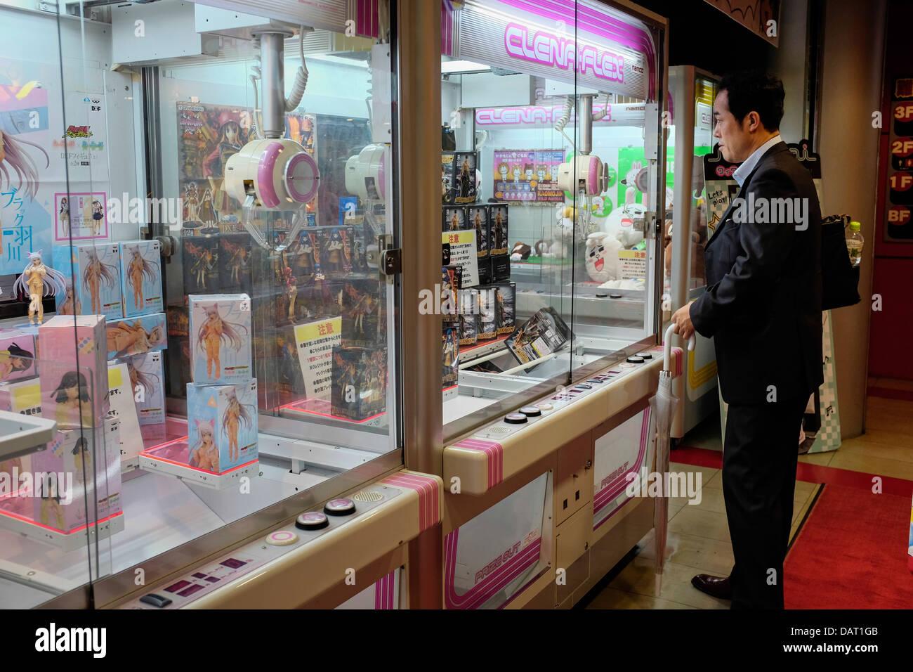 A Japanese Businessman playing an Arcade Claw Crane Game ... - photo#26