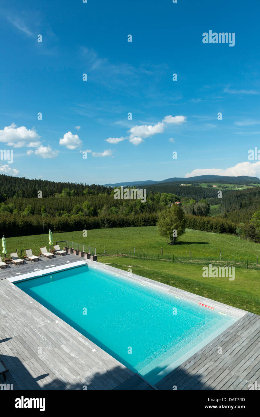 Outdoor swimming pool with a panoramic view of the Haute- Loire. Le ...
