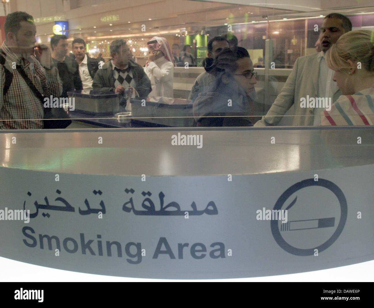 smokers gather at the smoking area of the 24 hours mall located ahead of the