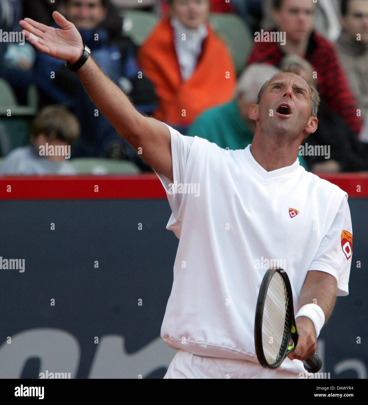 Former Austrian tennis pro Thomas Muster gestures during his match
