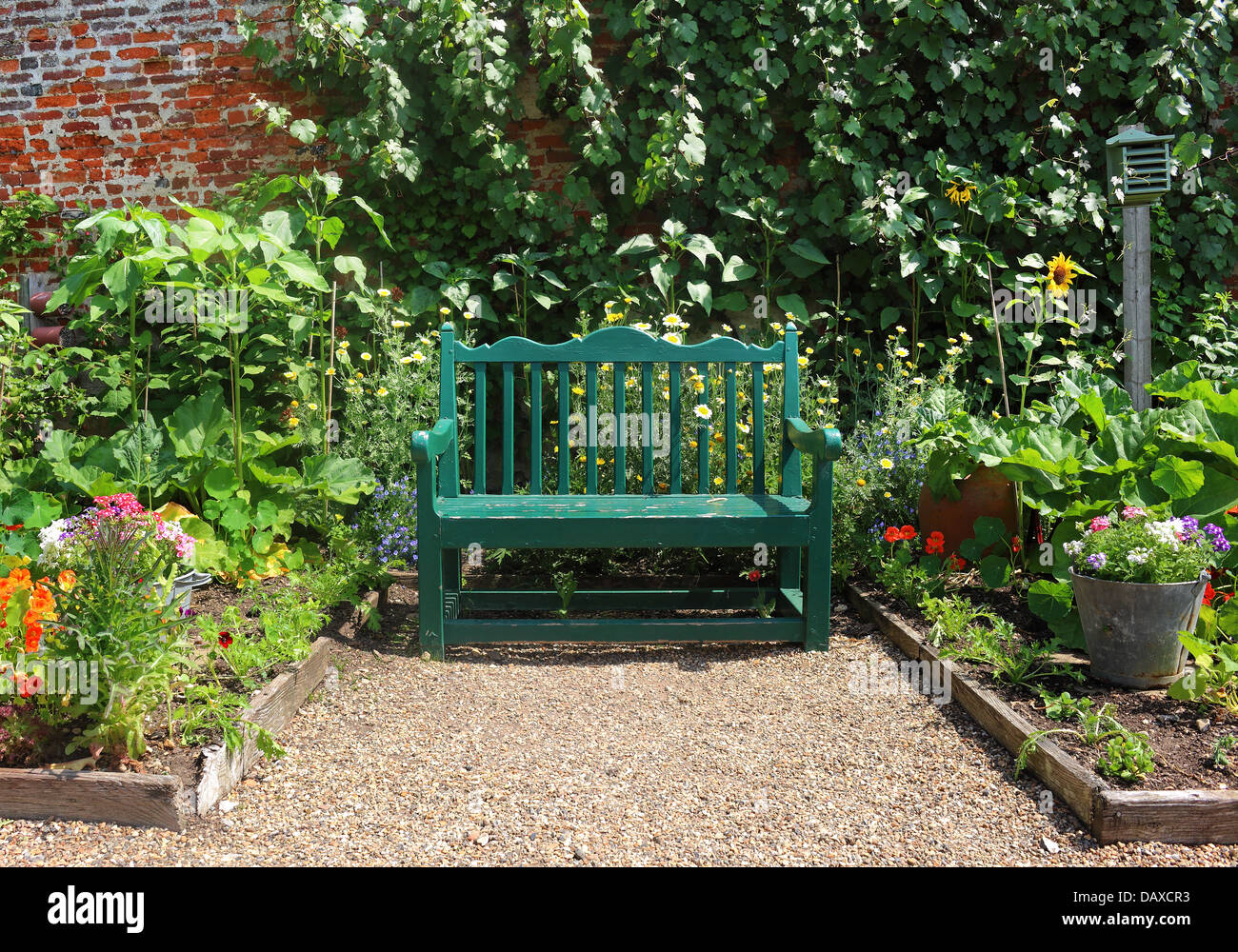 An english walled garden with seating area and bench seat for Garden seating areas