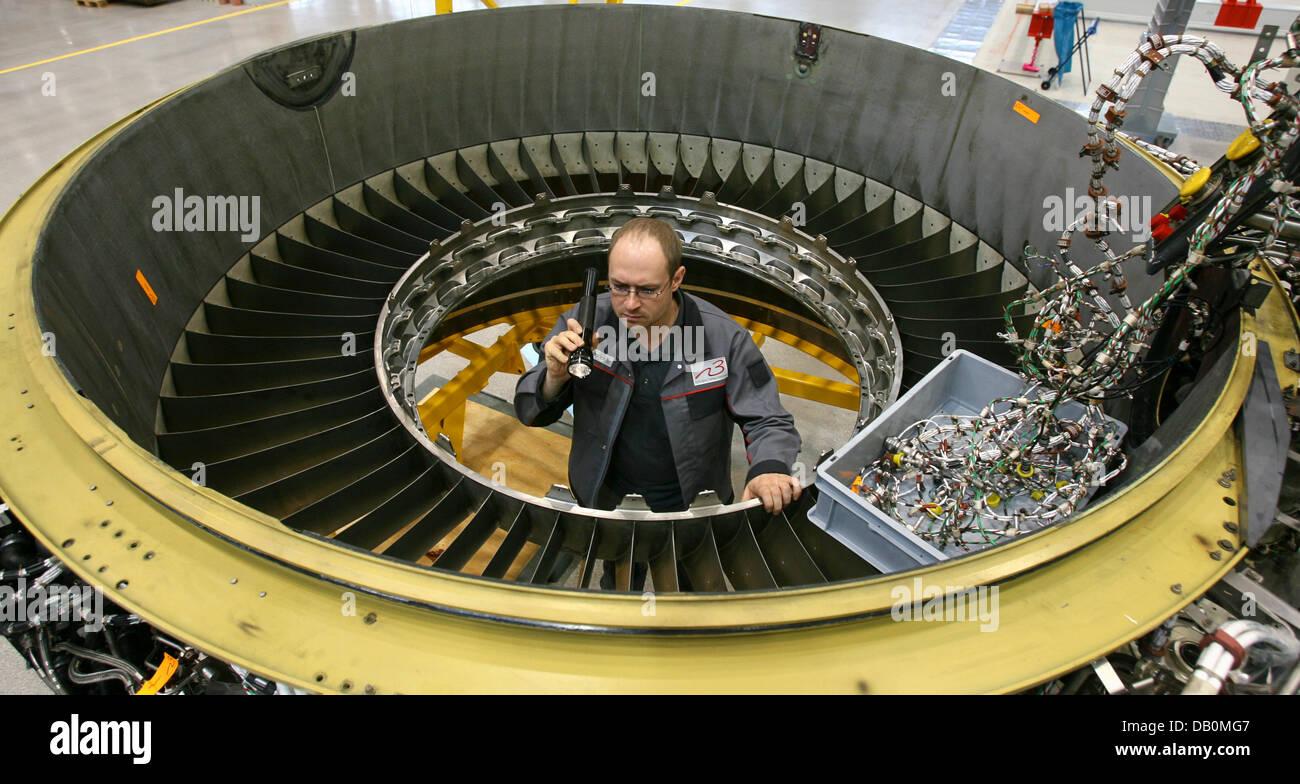 jet engine mechanic dirk heinrich checks a fan of a rolls royce trent 500 jet turbine engine mechanic