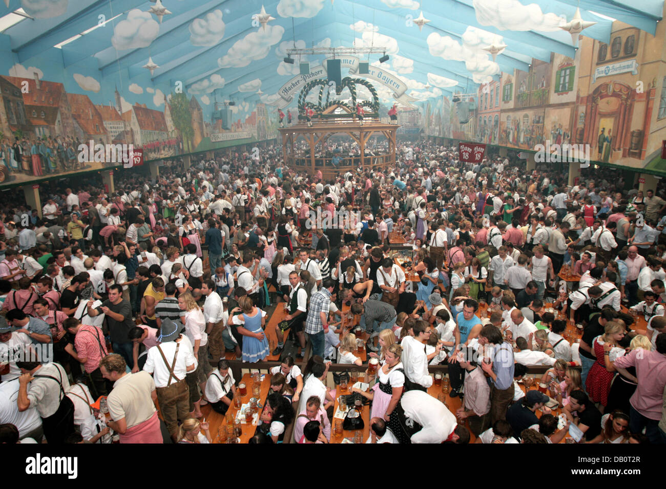 People celebrate at the crowded Hacker-Pschorr beer tent during the Oktoberfest in Munich Germany 22 September 2007. The 174th Oktoberfest the biggest ... & People celebrate at the crowded Hacker-Pschorr beer tent during ...