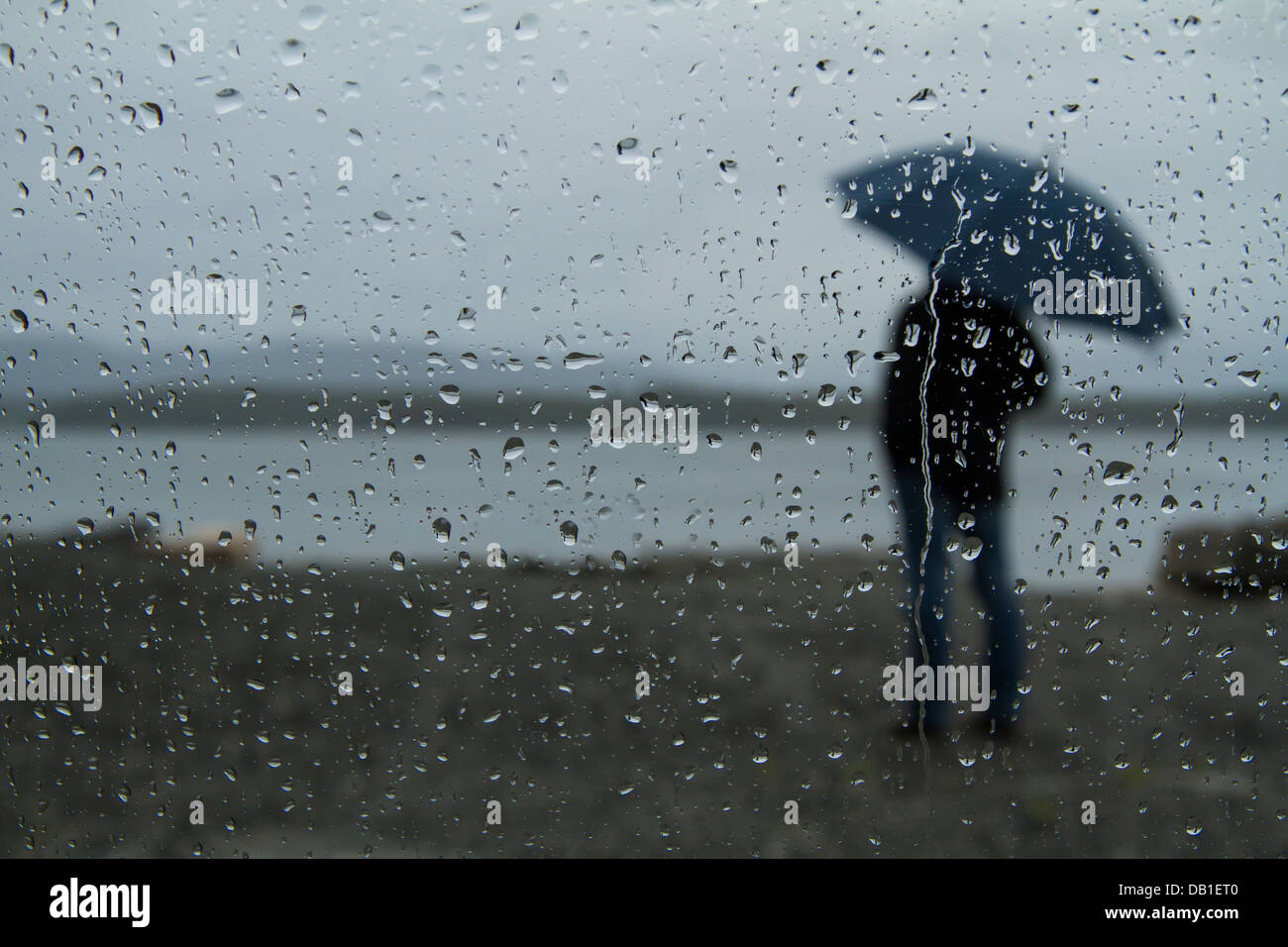 man standing alone in the rain wwwpixsharkcom images
