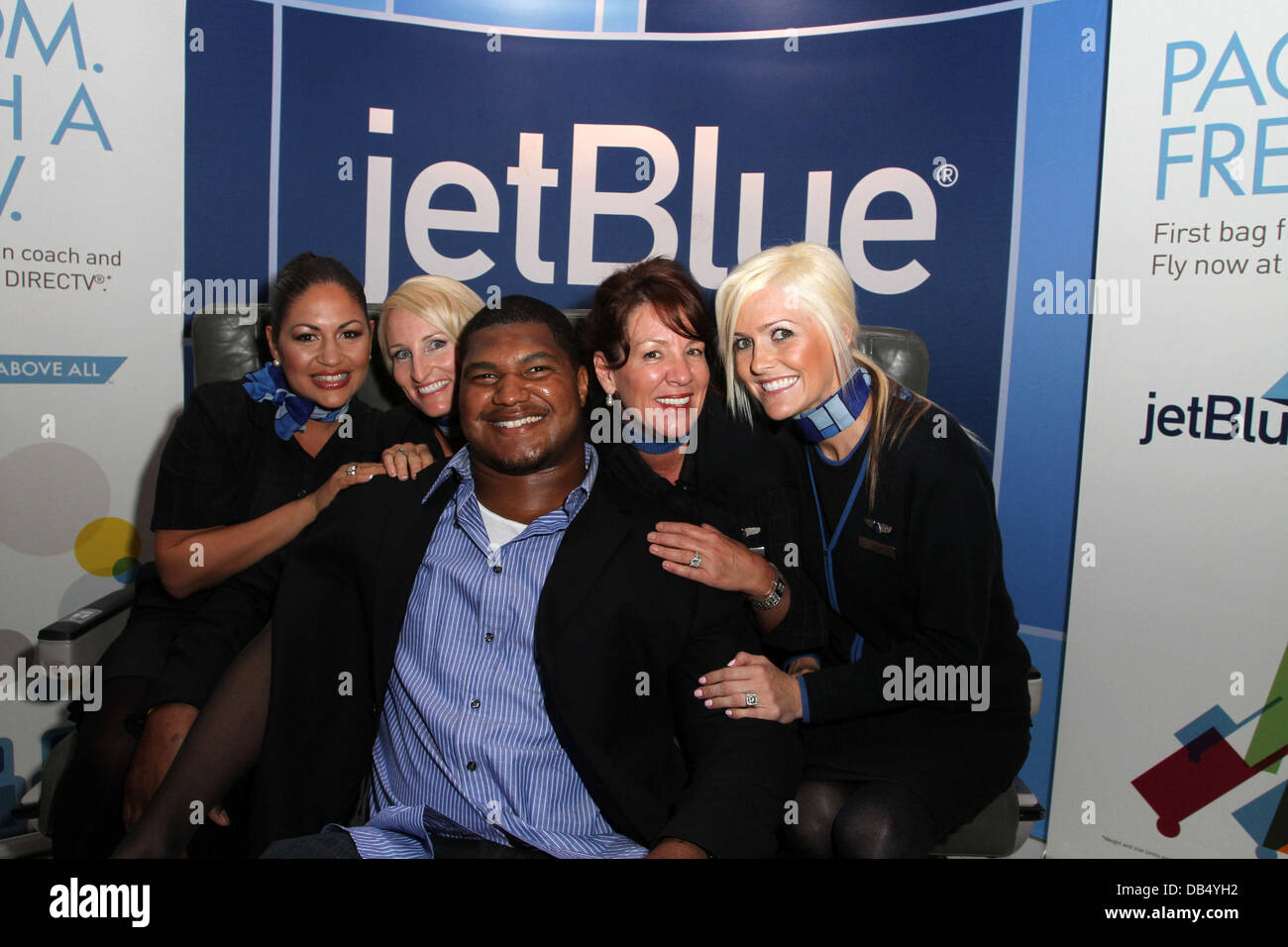 "Calais Campbell with Jet Blue Flight Attendants ""Pom Wonderful"