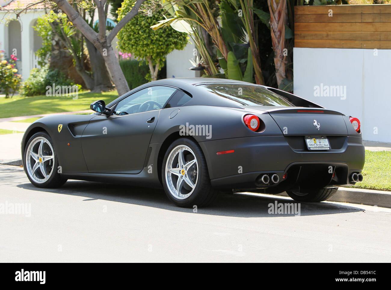 christian audigier and his girlfriend drive his matte black ferrari 599 gtb to look at houses in west hollywood los angeles california 220411 - Matte Black Ferrari 599