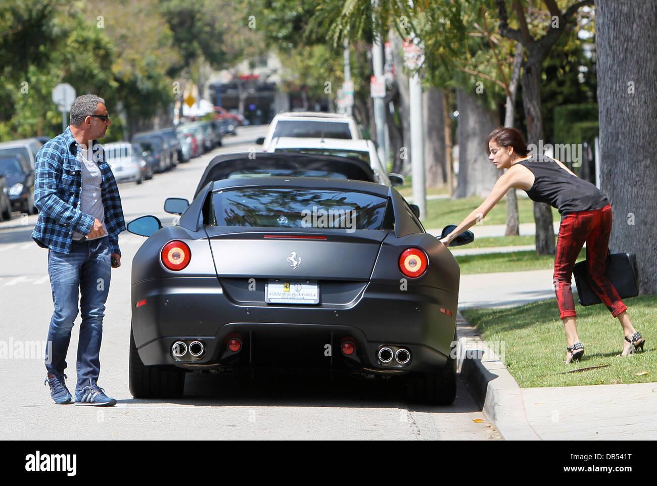 christian audigier and his girlfriend nathalie sorensen drive his matte black ferrari 599 gtb to look - Matte Black Ferrari 599