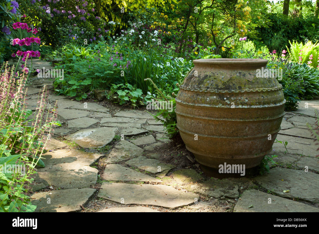 Captivating A Large Ornamental Terracotta Pot Sits On Stone Paving Within The Water  Garden Of Coton Manor Gardens, Northamptonshire, England