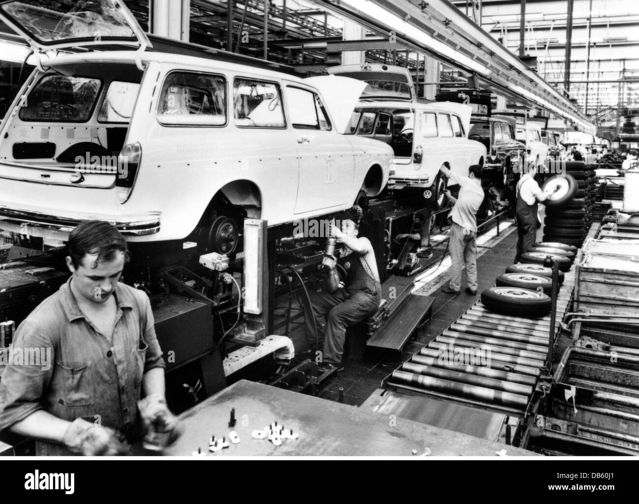 Industry cars volkswagen works in wolfsburg west germany interior view assembly of vw 1600 variant 1970s workers assembl