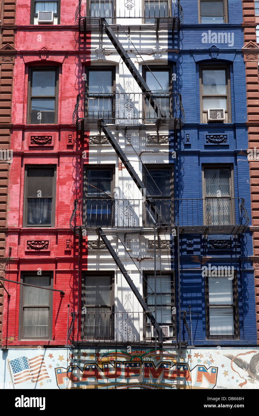 colorful apartment buildings with fire escapes in new york