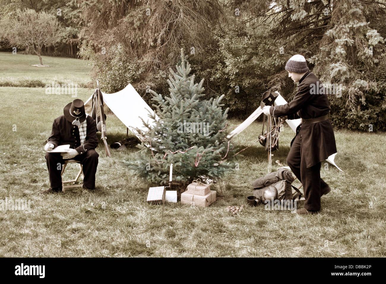Young Civil War soldier reenactors at Christmas time decorating a ...