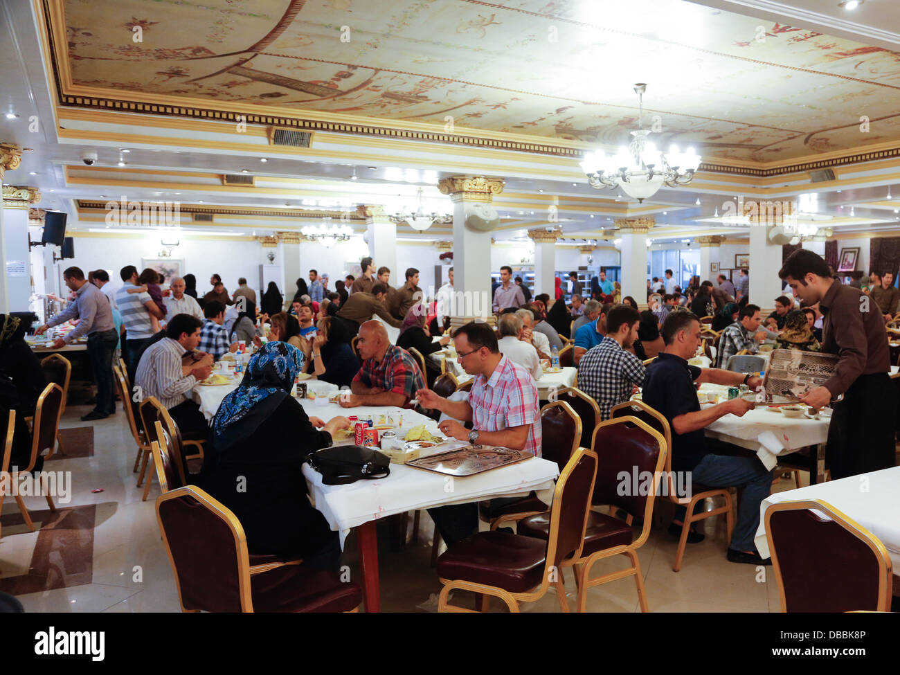 Crowded restaurant table - Patrons Eating At Hani Self Service Restaurant Tehran Iran Stock Image