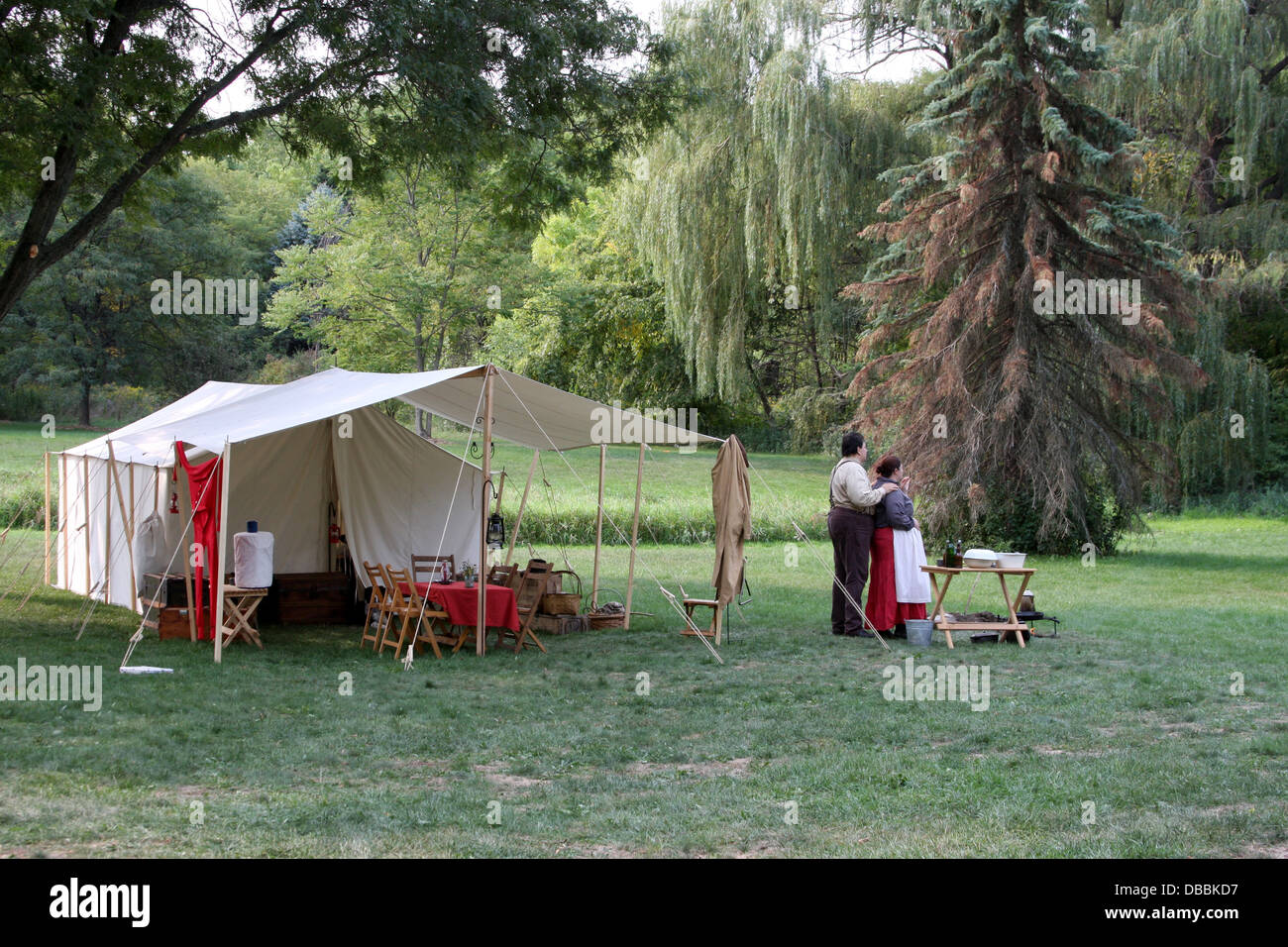 A couple c&ing with their western tent reenactment & A couple camping with their western tent reenactment Stock Photo ...