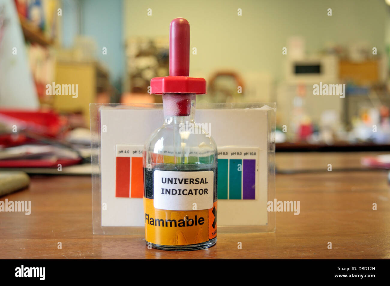 A small bottle of universal indicator with pH chart on a desk in a ... for Universal Indicator Solution  146hul