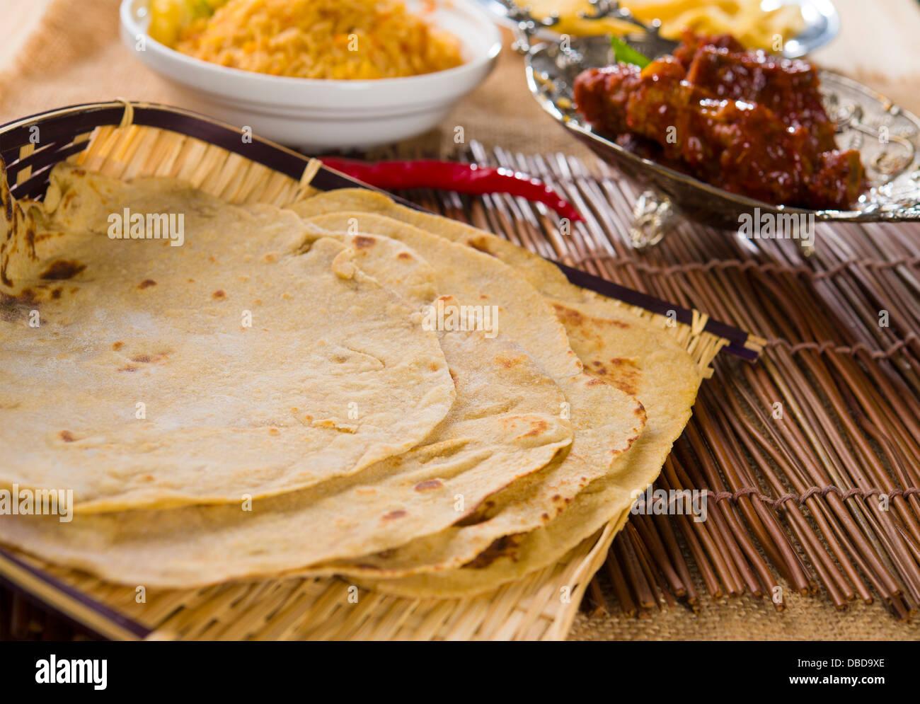 Chapatti roti, curry chicken, biryani rice, salad, masala ...