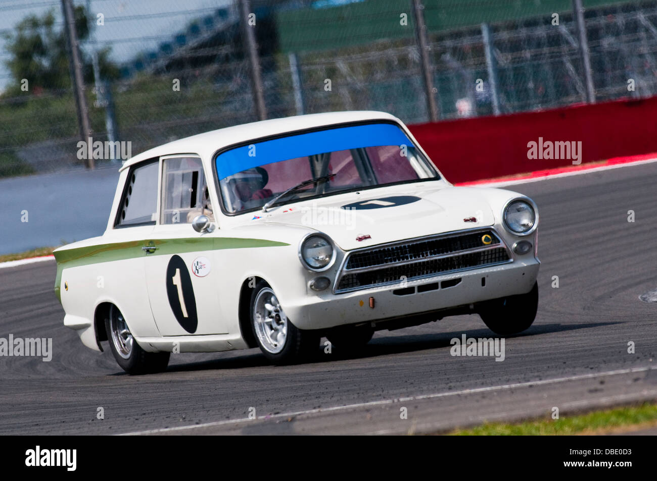 leo voyazides simon hadfield in a ford lotus cortina during the 2013 silverstone classic under