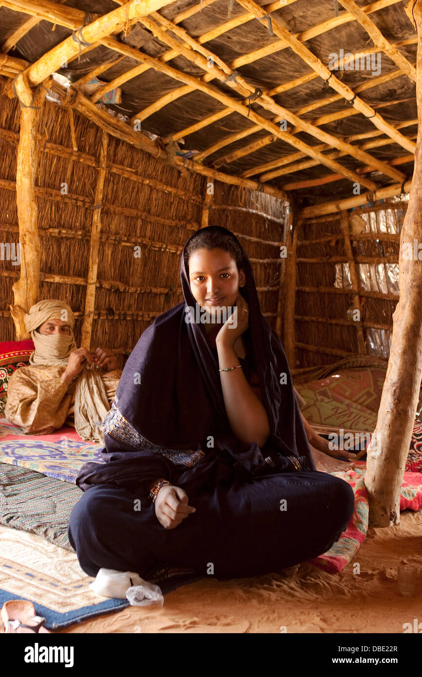 Inside Tuareg tent made from woven mats with village chief in the home of his married daughter and her husband NE Mali & Inside Tuareg tent made from woven mats with village chief in the ...