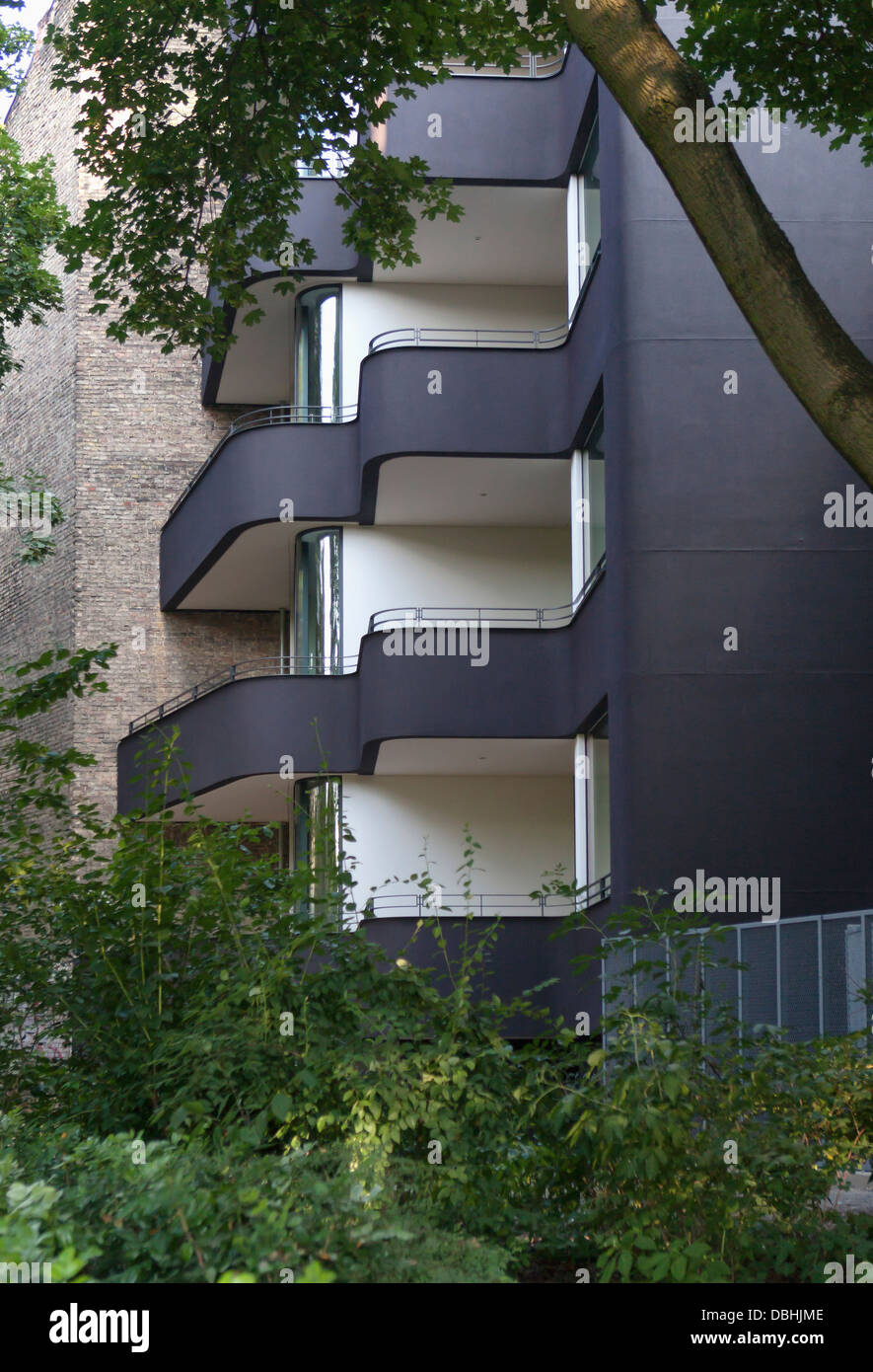 Sinuous curved black and white modern apartment building mitte berlin