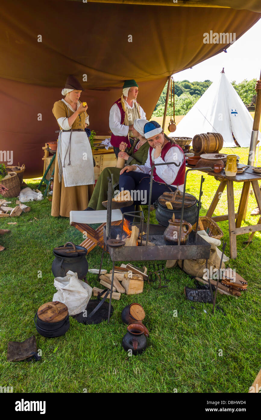 Medieval reenactment cooking kitchen tent with cooks food and utensils & Medieval reenactment cooking kitchen tent with cooks food and ...