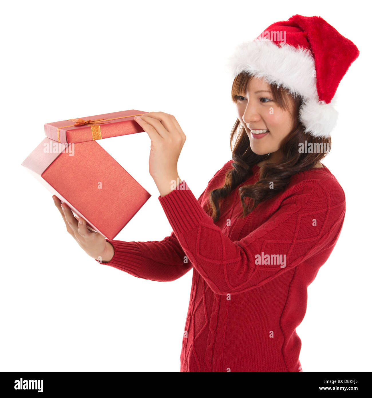 Christmas gift asian woman opening gift happy face young christmas gift asian woman opening gift happy face young beautiful smiling woman in santa hat funny cute photo of asian woman isolated on white negle Image collections