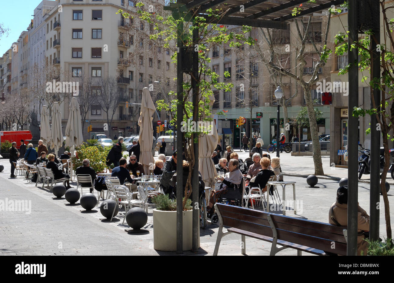 pedestrian street with pavement cafe the avenue de gaudi leading to the sagrada familia cathedral barcelona catalonia spain