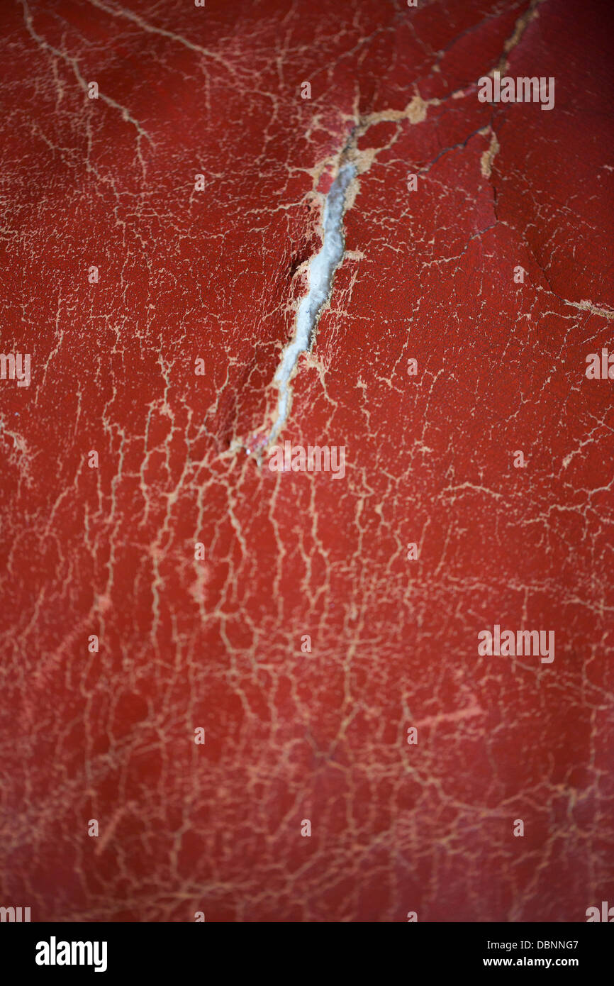 red leather worn textured background with a tear in the