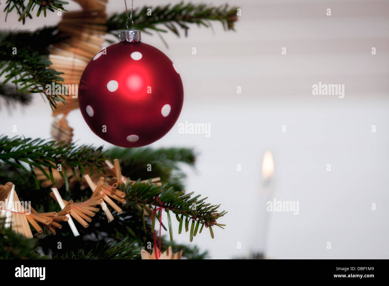 Christmas Baubles Germany : Christmas decoration bauble and burning candle munich